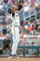 Michigan Wolverines pitcher Isaiah Paige (25) prays before pitching against the Vanderbilt Commodores during Game 2 of the NCAA College World Series Finals on June 25, 2019 at TD Ameritrade Park in Omaha, Nebraska. Vanderbilt defeated Michigan 4-1. (Andrew Woolley/Four Seam Images)