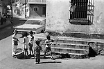 Mazatlan Mexico 1970s. Teen boy working selling food snacks to other children.  Rich, poor, poverty  economic divide.  1973 State of Sinaloa,