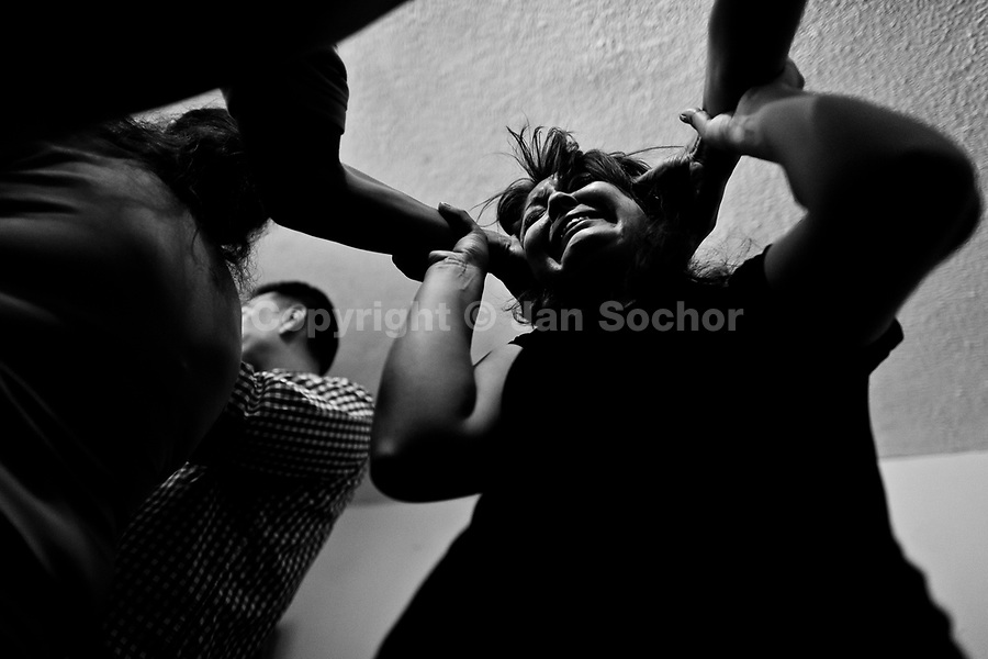 A Colombian pastor, pressing on a believer's head, attempts to evict a supposed demon during the exorcism ritual performed at a house church in Bogota, Colombia, 28 January 2013. Hundreds of Christian belivers, joined in nameless groups, gather every week in unmarked home churches dispersed in the city outskirts, to carry out prayers of liberation and exorcism. Community members and their religious activities are usually conducted by a charismatic pastor or preacher. Using either non-contactive methods (reading religous formulas from bible, displaying Christian symbols and icons) or rough body-pressure-points techniques and forced burping, a leading pastor commands the supposed evil spirit, which is generally believed to come from witchcraft, to depart a person's mind and body. The demon's expulsion often consists of multiple rites and may last for several months.