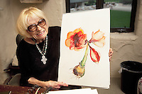 USA. California state. Napa valley. Margrit Biever Mondavi in her office at Robert Mondavi Winery, To Kalon Vineyard.She holds her latest painting in her arms. Margrit Biever Mondavi (born 1926 in Switzerland) is Vice President of Art and Culture at Robert Mondavi Winery which she joined in 1967. Under her direction, Robert Mondavi Winery developed original cultural and culinary arts programs. In 1980, she married Robert Mondavi and worked with him in many of his philanthropic activities. 16.12.2014 © 2014 Didier Ruef