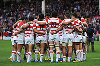 The Japan team huddle together after the match. Rugby World Cup Pool B match between Scotland and Japan on September 23, 2015 at Kingsholm Stadium in Gloucester, England. Photo by: Patrick Khachfe / Stewart Communications