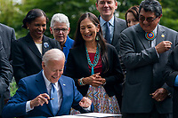United States President Joe Biden, with US Secretary of the Interior Deb Haaland, and White House National Climate Advisor Gina McCarthy, participates in a signing ceremony to restore and protect 3 national monuments on the North Lawn of the White House in Washington, DC, USA, 08 October 2021. President Biden during his remarks highlighted steps the Biden-Harris Administration is taking to better conserve and restore lands and waters that sustain the health of our communities, tackle the climate crisis, and power good jobs and a strong economy.<br /> CAP/MPI/RS<br /> ©RS/MPI/Capital Pictures
