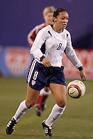 """USA's Angela Hucles. The US Women's National Team tied the Denmark Women's National Team 1 to 1 during game 8 of the 10 game the """"Fan Celebration Tour"""" at Giant's Stadium, East Rutherford, NJ, on Wednesday, November 3, 2004.."""