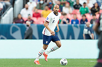DENVER, CO - JUNE 6: John Brooks #6 of the United States moves with the ball during a game between Mexico and USMNT at Mile High on June 6, 2021 in Denver, Colorado.