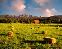 Old barn with hay and Wallowa Mountains. Near Halfway, Oregon