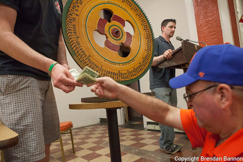 The green wheel spun to match the winning tickets  at a meat raffle at the  Moose Lodge in Lancaster, NY. Meat raffles have become poular fundraisers in Western New York. April 17, 2016