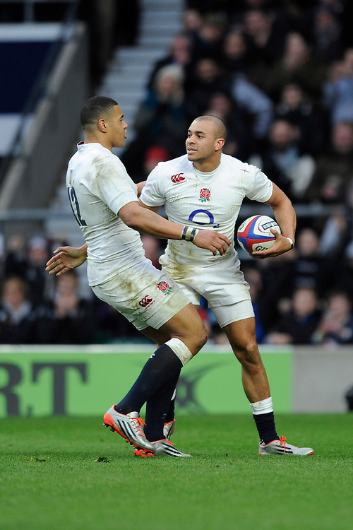 Jonathan Joseph of England celebrates his second try with team mate Luther Burrell of England during the RBS 6 Nations match between England and Italy at Twickenham Stadium on Saturday 14th February 2015 (Photo by Rob Munro)