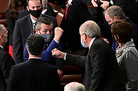 United States Senator Ted Cruz (Republican of Texas), left, wears a protective mask while gesturing during a joint session of Congress to count the Electoral College votes of the 2020 presidential election in the House Chamber in Washington, D.C., U.S., on Wednesday, Jan. 6, 2021. Congress is meeting to certify Joe Biden as the winner of the 2020 presidential election, with scores of Republican lawmakers preparing to challenge the tally in a number of states during what is normally a largely ceremonial event. <br /> Credit: Erin Scott / Pool via CNP/AdMedia