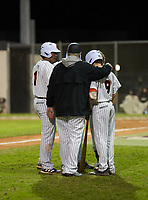Sarasota Sailors head coach Clyde Metcalf talks with Garrett Browning (9) and Daniel Torrealba (11) during a game against the Riverview Rams on February 19, 2021 at Rams Baseball Complex in Sarasota, Florida. (Mike Janes/Four Seam Images)