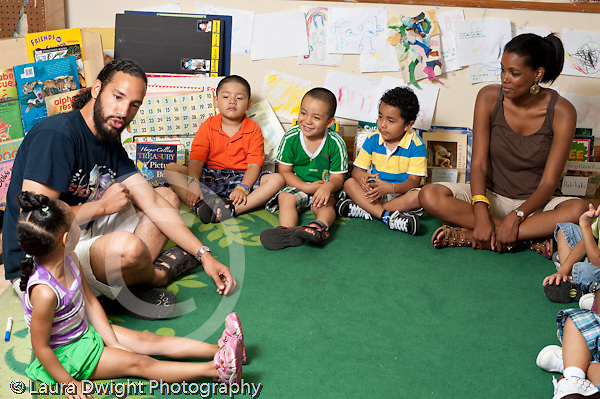 Education Preschool 3-5 year olds circle time teachers talking with group of children horizontal