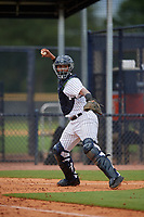 GCL Yankees East catcher Hemmanuel Rosario (7) throws down to first base during a Gulf Coast League game against the GCL Phillies West on July 26, 2019 at the New York Yankees Minor League Complex in Tampa, Florida.  (Mike Janes/Four Seam Images)