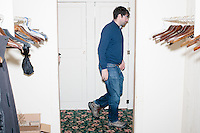 Senior Cruz adviser Ethan Zorfas walks to a private area where Texas senator and Republican presidential candidate Ted Cruz is before speaking at a town hall at The Alpine Grove banquet center in Hollis, New Hampshire.