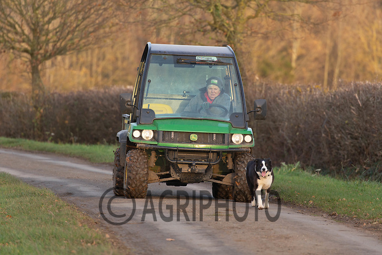 24.11.2020 Shepherdess driving a John Deere gator down the road<br /> ©Tim Scrivener Photographer 07850 303986<br />      ....Covering Agriculture In The UK....
