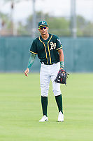 Oakland Athletics outfielder Jose Bonilla (18) warms up before an exhibition game against Team Italy at Lew Wolff Training Complex on October 3, 2018 in Mesa, Arizona. (Zachary Lucy/Four Seam Images)