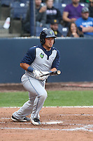 Elvin Soto #7 of the Hillsboro Hops bats against the Vancouver Canadians at Nat Bailey Stadium on July 24, 2014 in Vancouver, British Columbia. Vancouver defeated Hillsboro, 5-2. (Larry Goren/Four Seam Images)