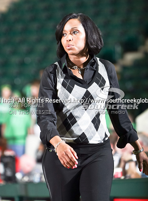 North Texas Mean Green North Texas Mean Green Head Coach Shanice Stephens watches her team during the NCAA Women's basketball game between the South Alabama Jaguars and the University of North Texas Mean Green at the North Texas Coliseum,the Super Pit, in Denton, Texas. South Alabama defeated UNT 79 to 61.