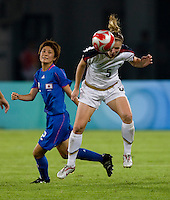 USWNT midfielder (5) Lindsay Tarpley heads the ball away from Japanese defender (2) Yukari Kinga while playing at Worker's Stadium.  The USWNT defeated Japan, 4-2, during the semi-finals of the Beijing 2008 Olympics in Beijing, China.