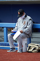 San Francisco Giants scout Paul Faulk looks over notes during game four of the South Atlantic Border Battle at Truist Point on September 27, 2020 in High Pont, NC. (Brian Westerholt/Four Seam Images)