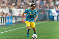 FOXBOROUGH, MA - AUGUST 8: Alejandro Bedoya #11 of Philadelphia Union dribbles down the wing during a game between Philadelphia Union and New England Revolution at Gillette Stadium on August 8, 2021 in Foxborough, Massachusetts.
