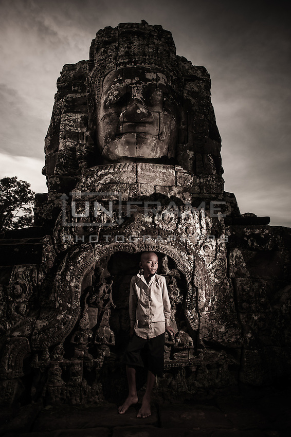 UNESCO World Heritage Site,  Ankgor wat temples and portraits of local children who usually make their living by selling crafts and other products to tourists.   Seam Reap, Cambodia.