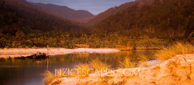 Sunset over Kohaihai River and coastal forest near Karamea, Kahurangi National Park, Buller Region, West Coast, New Zealand, NZ