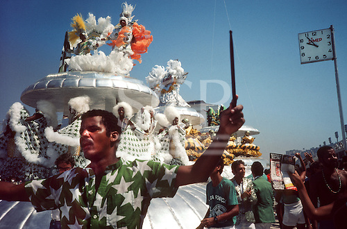 Rio de Janeiro, Brazil. Samba dancers on a huge float during the carnival parade; drummer in green starry shirt.