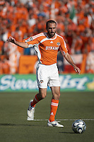 Houston Dynamo defender Ryan Cochrane clears the ball out of the box.  The Houston Dynamo win MLS Cup 2006 over the New England Revolution after playing to a 1-1 tie during regulation and extra time at Pizza Hut Park in Frisco, TX on November 12, 2006.
