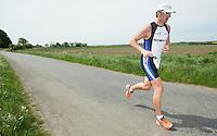 26 MAY 2013 - BRIGG, GBR - Phil Binch (Masters 40) of Lincsquad during the run at the 2013 Brigg Bomber Quadrathlon, a World Quadrathlon Federation World Cup round and the British Championships, held in Brigg, Lincolnshire, Great Britain.(PHOTO (C) 2013 NIGEL FARROW)