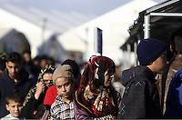 Pictured: Refugees queue for food Thursday 25 February 2016<br /> Re: Refugees have been left stranded in temporary camps after Greek FYRO Macedonian borders were closed in Idomeni, northern Greece.