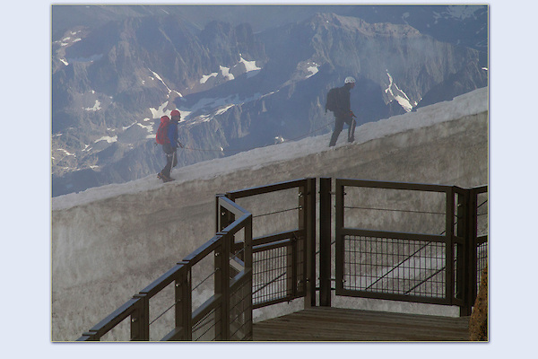 Photoshop composite. Armchair mountaineer, are you a doer or viewer? <br /> Mountaineers ascend Mt Blanc, Chamonix, France.