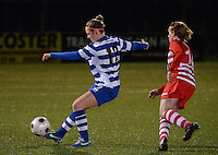 20140221 - OOSTAKKER , BELGIUM : Gent Pauline Windels (l) pictured during the soccer match between the women teams of AA Gent Ladies  and RAFC Antwerp Ladies , on the 19th matchday of the BeNeleague competition Friday 21 February 2014 in Oostakker. PHOTO DAVID CATRY