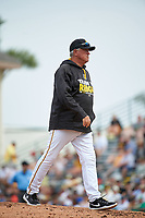 Pittsburgh Pirates manager Clint Hurdle (13) walks back to the dugout after a mound visit during a Spring Training game against the Toronto Blue Jays  on March 3, 2016 at McKechnie Field in Bradenton, Florida.  Toronto defeated Pittsburgh 10-8.  (Mike Janes/Four Seam Images)