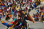 """A monk perfoms during annual Thimpu Tshechu. The Tshechu is a festival honouring Guru Padmasambhava, """"one who was born from a lotus flower."""" This Indian saint contributed enormously to the diffusion of Tantric Buddhism in the Himalayan regions of Tibet, Nepal, Bhutan etc. around 800 AD. He is the founder of the Nyingmapa, the """"old school"""" of Lamaism which still has numerous followers. The biography of Guru is highlighted by 12 episodes of the model of the Buddha Shakyamuni's life. Each episode is commemorated around the year on the 10th day of the month by """"the Tschechu"""". The dates and the duration of the festivals vary from one district to another but they always take place on or around the 10th day of the month according to the Bhutanese calendar. During Tshechus, the dances are performed by monks as well as by laymen. The Tshechu is a religious festival and by attending it, it is believed one gains merits. It is also a yearly social gathering where the people, dressed in all their finery, come together to rejoice. Arindam Mukherjee.."""