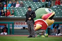 Mike Rainbow Trout performs behind umpire John Bacon during a Rochester Red Wings International League game against the Charlotte Knights on June 16, 2019 at Frontier Field in Rochester, New York.  Rochester defeated Charlotte 11-5 in the first game of a doubleheader that was a continuation of a game postponed the day prior due to inclement weather.  (Mike Janes/Four Seam Images)