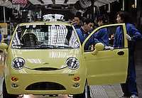 Workers operating on the assembly line of Chery Automobile Co. LTD in Wuhu, Anhui Province, China. Along with other auto makers in China, Chery is now looking overseas to sell its vehicles as stock increases and domestic margine declines. China is currently the wrold's 4th largest auto maker, plans to boost vehicle and automobile components exports by 15 folds to more than 120 billion yuan (15 billion US) in the next 10 years..18 Jan 2006