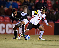 Tsubasa Endoh (31) of Maryland fights for the ball with George Hodge (3) of Providence during the second round of the NCAA tournament at Ludwig Field in College Park, MD.  Maryland defeated Providence, 3-1.