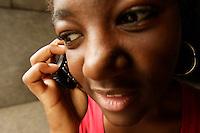 Montreal QC CANADA -Model Release Illustration Photo -<br /> Teenager female talking on her cellular phone homework outside