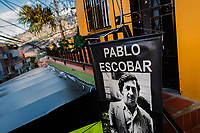 "A banner, depicting the drug lord Pablo Escobar, is seen hung above a barber shop in the Pablo Escobar neighborhood, Medellín, Colombia, 6 December 2017. Twenty five years after Pablo Escobar's death, the legacy of the Medellín Cartel leader is alive and flourishing. Although many Colombians who lived through the decades of drug wars, assassinations, kidnappings, reject Pablo Escobar's cult and his celebrity status, there is a significant number of Colombians who admire him, worshipping the questionable ""Robin Hood"" image he had. Moreover, in the recent years, the popular ""Narcos"" TV series has inspired thousands of tourists to visit Medellín, creating a booming business for many but causing a controversial rise of narco-tourism."