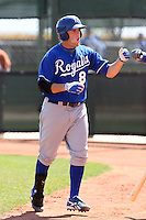 Mike Moustakas #8 of the Kansas City Royals is greeted at the dugout after hitting a homerun in a minor league spring training game against the Seattle Mariners at the Royals complex on March 26, 2011  in Surprise, Arizona. .Photo by:  Bill Mitchell/Four Seam Images.