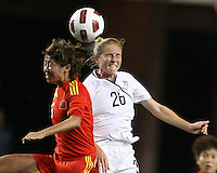 Rachel Buehler #26 of the USA WNT goes for a header with Na Zhang #6 of the PRC WNT during an international friendly match at PPL Park, on October 6 2010 in Chester, PA. The game ended in a 1-1 tie.
