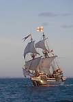 The Golden Hind, Sir Francis Drake?s historic 16th century sailing ship replica under full sail, off the US west coast at sunrise, commemorating Drake's around the world Voyage of Discovery, (1577-1580), property released,.