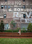 A visitor rests along the High Line which is a public park built on a 1.45-mile-long elevated rail structure running from Gansevoort Street to West 34th Street on Manhattan's West Side, New York City.