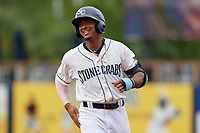 Charlotte Stone Crabs Wander Franco (1) celebrates with teammates after a walk-off win during a Florida State League game against the Bradenton Maruaders on August 7, 2019 at Charlotte Sports Park in Port Charlotte, Florida.  Charlotte defeated Bradenton 3-2 in the second game of a doubleheader.  (Mike Janes/Four Seam Images)