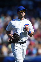 Chicago Cubs outfielder Justin Ruggiano (20) jogs to the dugout during a game against the Milwaukee Brewers on August 14, 2014 at Wrigley Field in Chicago, Illinois.  Milwaukee defeated Chicago 6-2.  (Mike Janes/Four Seam Images)
