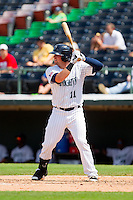 Andy Wilkins (11) of the Charlotte Knights at bat against the Gwinnett Braves at Knights Stadium on July 28, 2013 in Fort Mill, South Carolina.  The Knights defeated the Braves 6-1.  (Brian Westerholt/Four Seam Images)