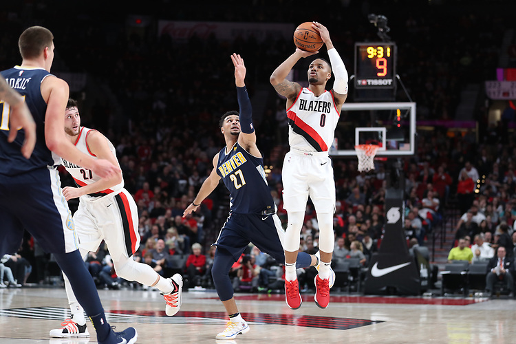 Portland Trail Blazers guard Damian Lillard (0) shoots over Denver Nuggets guard Jamal Murray (27) in the second half at Moda Center. <br /> Photo by Jaime Valdez