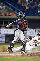 Bowing Green Hot Rods catcher David Rodriguez (7) stretches for a throw as Kyle Tucker (19) slides home during a game against the Quad Cities River Bandits on July 24, 2016 at Modern Woodmen Park in Davenport, Iowa.  Quad Cities defeated Bowling Green 6-5.  (Mike Janes/Four Seam Images)