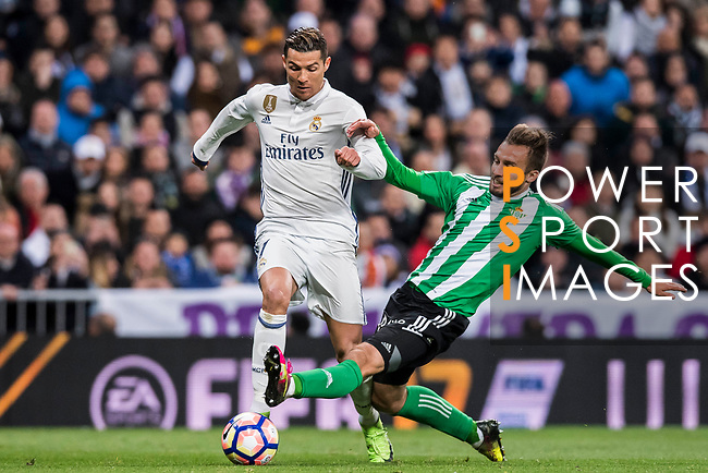 Cristiano Ronaldo (l) of Real Madrid battles for the ball with German Pezzella of Real Betis during their La Liga match between Real Madrid and Real Betis at the Santiago Bernabeu Stadium on 12 March 2017 in Madrid, Spain. Photo by Diego Gonzalez Souto / Power Sport Images