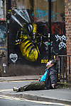 © Joel Goodman - 07973 332324 . 06/04/2017 . Manchester , UK . A man appears disorientated and is incoherent as he sits forward on the pavement on Newton Street . An epidemic of abuse of the drug spice by some of Manchester's homeless population , in plain sight , is causing users to experience psychosis and a zombie-like state and is daily being witnessed in the Piccadilly Gardens area of Manchester , drawing large resource from paramedic services in the city centre . Photo credit : Joel Goodman