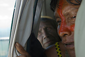 Pará State, Brazil. Cacique Kryt Kayapo in a small aircraft, looking down at the new road along their reserve.
